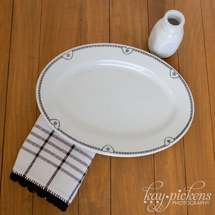 white dishes with black trim and matching tea towel