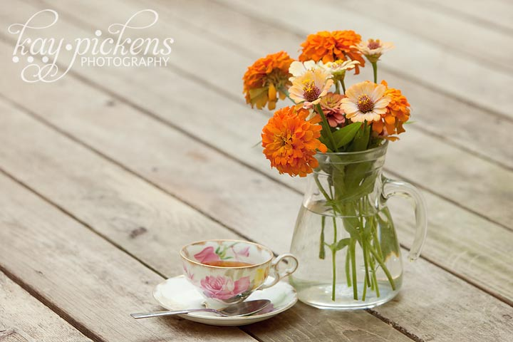 tea and flowers with antique teacup