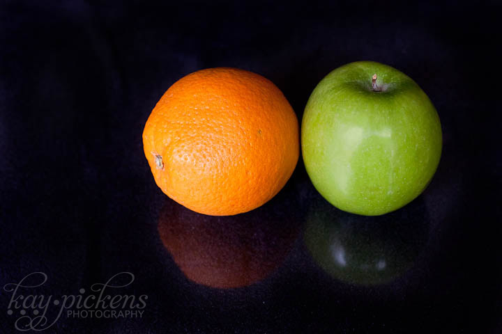 fruit on black background with plexi-glass