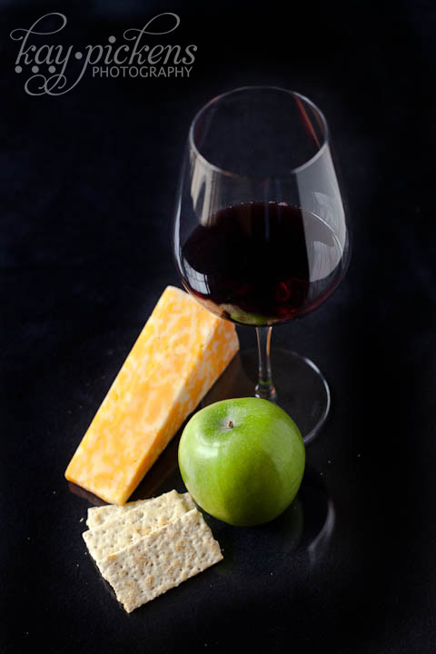 wine and cheese on black